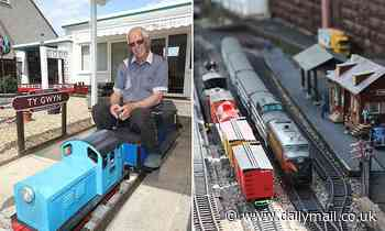 All aboard! Model railway enthusiast turns his garden into tourist attraction creating ride-on train