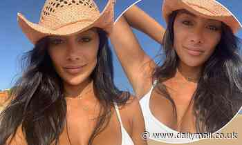 Nicole Scherzinger puts on a busty display in a white crop top in the Mexican desert