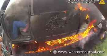 Watch: Police Race to Rescue Man Trapped in Burning Truck, Drag Him to Safety Seconds Before It Explodes