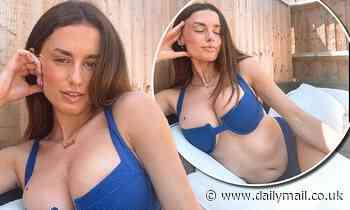 Love Island's Amber Davies flaunts her abs in an electric blue bikini