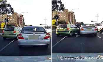 'Cheeky' P-plate driver pushes in front of another car at set of traffic lights