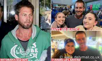Ben Cousins looks happy and healthy at a West Coast Eagles AFL game as he poses for photos with fans