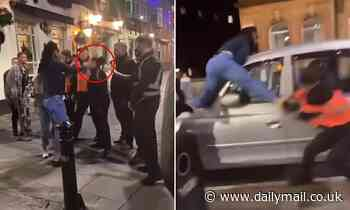 Reveller slaps female bouncer and climbs on top of taxi as doormen chase him
