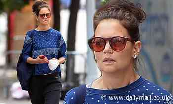 Katie Holmes makes the rare move of pulling her face mask off in New York City