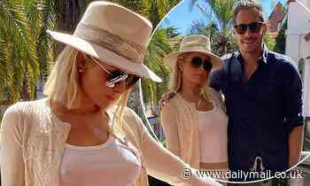 Paris Hilton cosies up to her fiancéCarter Reum during a romantic getaway to South Africa