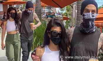 Kourtney Kardashian and her beau Travis Barker snuggle up on a coffee run