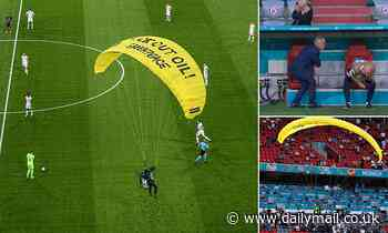 Greenpeace parachutist smashes into spidercam wires above France Germany stadium at Euro 2020 game