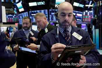 Stocks slip ahead of Fed decision, oil tops $71 level