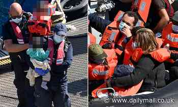 Dozens of migrants including young children and baby are picked up in English Channel