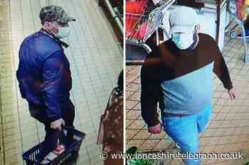 Police release images of two men following theft from elderly shopper in Aldi store