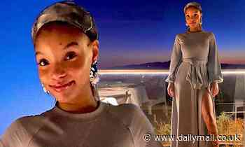 Halle Bailey looks demure in a grey maxi dress as she takes a break from filming The Little Mermaid