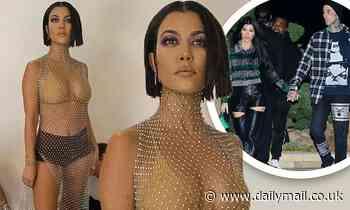 Kourtney Kardashian is seen in a sheer top over a nude bra