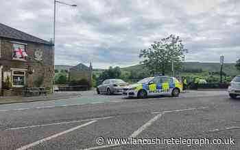 Road closed following incident off Grane Road