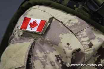 Armed Forces personnel assess possible 'old' military shell in North Vancouver home