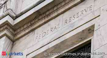 Fed walks tightrope between big jobs gap and rising inflation - Economic Times