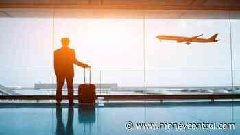 Britain considers vaccine passports to restart international travel - Moneycontrol