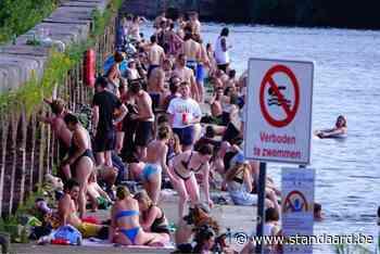 Massa volk op illegale zwemspot in Gent ondanks zwemgevaar - De Standaard