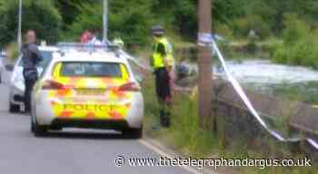 Police scene in place after man's body found in water in Shipley