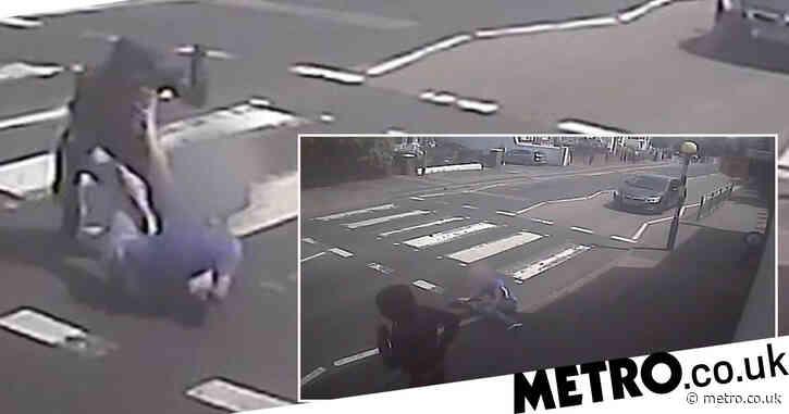 Hunt for hooded knifeman after boy stabbed on zebra crossing