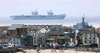 Mind-bending photos show Royal Navy warship 'flying' through air above sea