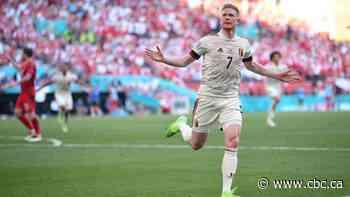 Belgium bests Denmark in game marked by Eriksen tribute