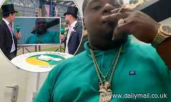 Big Narstie drags on a suspicious-looking cigarette before realising he is LIVE on ITV Racing