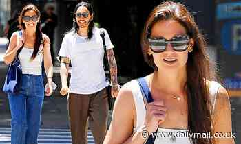 Katie Holmes beams with joy as she steps out in NYC with mystery man