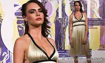 Cara Delevingne wows in a plunging gold fringe dress  at the Dior Cruise fashion show in Athens