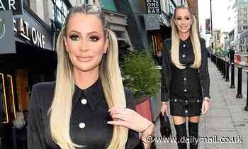 Olivia Attwood cuts a stylish figure in a black dress and thigh-high boots in Manchester