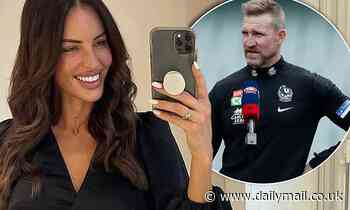 Nathan Buckley's girlfriend Alex Pike wears a large diamond ring on what