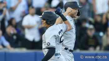 Stanton homer, unprecedented triple play help Yankees complete sweep of Blue Jays
