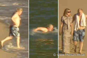 Boris Johnson channels David Hasselhoff as he runs straight into the sea for a swim before drying off with... - The Sun