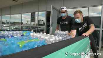 Regina Community Fridge gets water donation from local radio station - CTV News