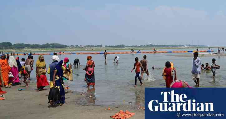 Indian boatman tells of finding baby in a box floating on Ganges - The Guardian