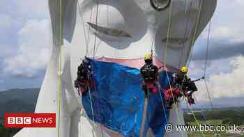 Giant Buddhist statue gets Covid face mask in Japan