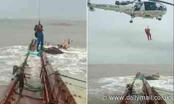 Dramatic moment Indian coastguard airlifts sailors off a sinking ship as huge waves break over deck