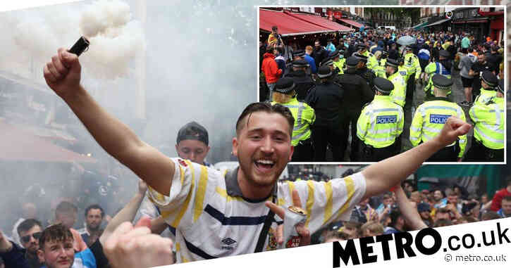 Boozed up football fans set off flares as cops try to keep streets under control
