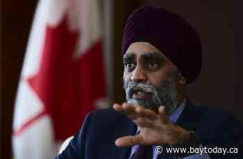 Trudeau defends Sajjan, accuses Tories of slandering embattled defence minister