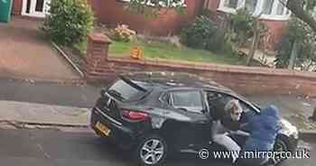 Moment mum scrambles to save her toddler as thugs steal car in knifepoint ambush