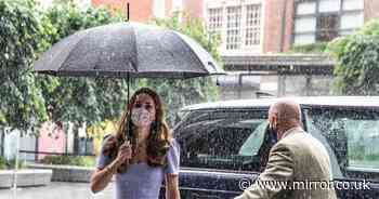 Kate Middleton hides from rain as she launches new Centre for Early Childhood