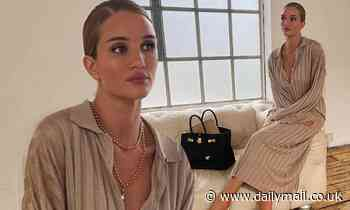 Rosie Huntington-Whiteley puts on a stylish display in a plunging Victoria Beckham midi dress