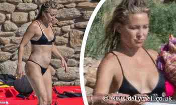 Kate Hudson shows off her abs in a skimpy black bikini as she enjoys more beach time in Greece