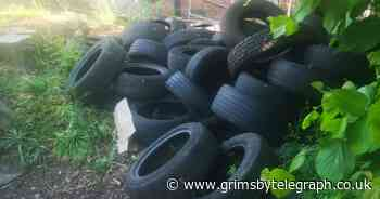 Search for fly-tipper who dumped dozens of tyres on Grimsby corner - Grimsby Live
