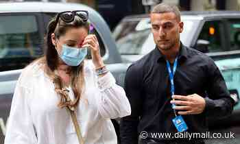 Kelly Brook is escorted into Heart FM by security as football fans pack into Leicester Square