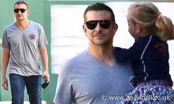 Bradley Cooper is on dad duty as he carries daughter Lea in New York City
