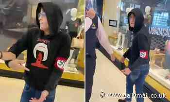 Moment 17-year-old boy is kicked out of a mall in Brazil for wearing a swastika armband