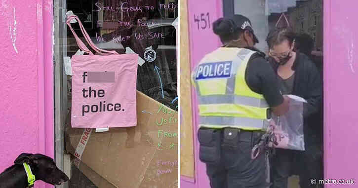 Cafe boss charged for 'f**k the police' bag display in front window