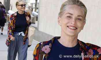 Sharon Stone, 63, looks youthful in baggy pants and floral button-down as she flashes peace sign