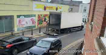 Gloucester shop's delivery lorry parks in road after bollards installed on pavement - Gloucestershire Live