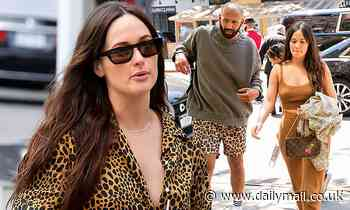 Kacey Musgraves can't contain her grin as she walks hand-in-hand with writer Cole Schafer in NYC
